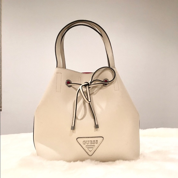 Guess Handbags - Guess purse with shoulder strap.
